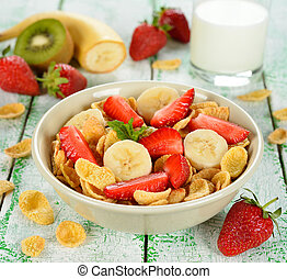 Cornflakes with fruits on a white table