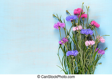 Cornflowers on blue background