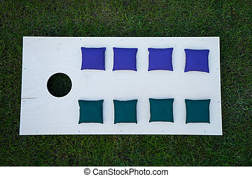 Cornhole board flat lay on grass - Flat lay of cornhole...