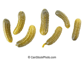 Cornichons - small pickled cucumbers isolated on a white background. Top view.