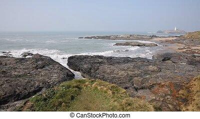 Cornish coast and lighthouse Godrev - Godrevy lighthouse and...