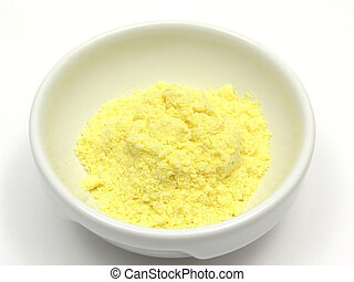 Cornmeal in a bowl of chinaware on white background