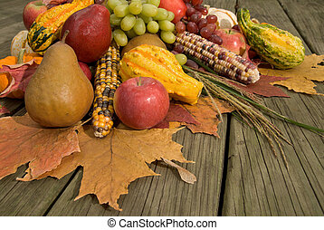 Cornucopia filled with fall harvest spilling out of it's ...