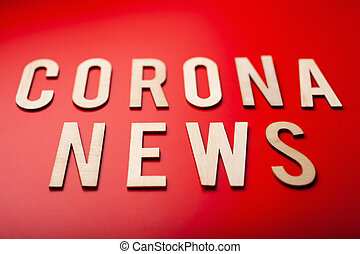 corona news word text wooden letter on red background ...