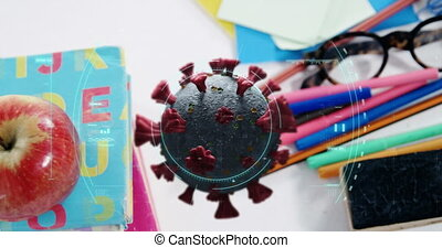 Animation of Covid 19 coronavirus cell spinning, scope scanning over desk with school items. Education back to school coronavirus pandemic concept digitally generated image.
