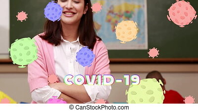 Animation of Covid 19 text and coronavirus cells spreading over smiling female teacher and pupils in class. Education back to school coronavirus pandemic concept digitally generated image.