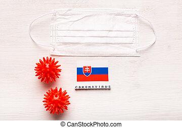 Coronavirus covid-19 concept. Top view protective breathing mask and flag of Slovakia. Novel Chinese Coronavirus outbreak.