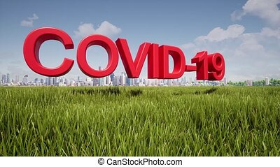 Coronavirus inscription on the background of green grass and the city COVID-19