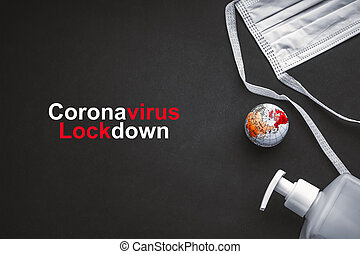 CORONAVIRUS LOCKDOWN text with antibacterial soap sanitizer, world globe and protective face mask on black background. Covid-19 or Coronavirus Concept