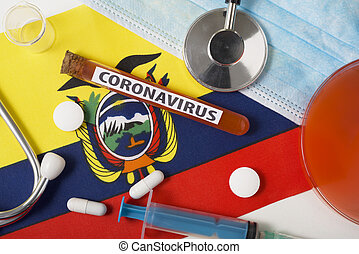 Coronavirus, nCoV concept. Top view protective breathing mask, stethoscope, syringe, tablets on the flag of Ecuador.