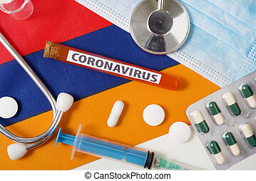 Coronavirus, nCoV concept. Top view protective breathing mask, stethoscope, syringe, tablets on the flag of Armenia.