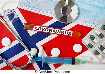 Coronavirus, nCoV concept. Top view protective breathing mask, stethoscope, syringe, tablets on the flag of Norway.