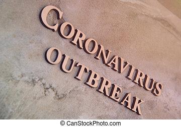 coronavirus outbreak word written on wooden letters.