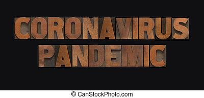 Coronavirus pandemic words in wood type on black