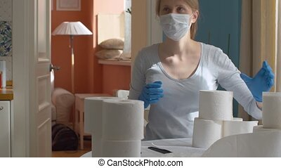 Young woman with a lot of toilet paper