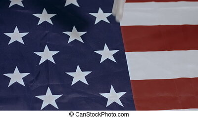 Swab tests for Coronavirus falling on Usa flag. Slow motion