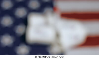 Coronavirus test with I voted stickers on american flag. ...