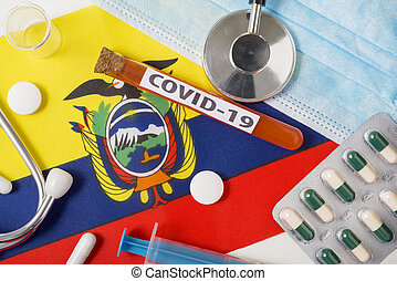 Coronavirus, the concept COVid-19. Top view protective breathing mask, stethoscope, syringe, tablets on the flag of Ecuador.