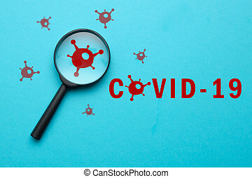 Coronovirus covid-19 answers and questions concept - magnifier with virus sign on blue background.