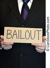 Corporate Bailout - Closeup of a businessman holding a...