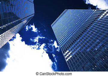 Corporate building on a dark blue sky with cloud