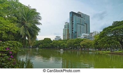 corporate buildings overlooking the green park with a lake....
