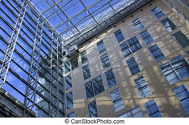 Low down view of reflecting windows of corporate business buildings