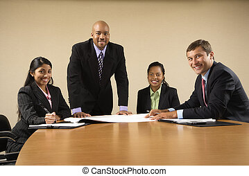 Corporate business. - Businesspeople having meeting at...