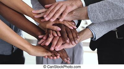 Corporate business team people stack hands together in pile...
