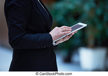 business woman working on tablet