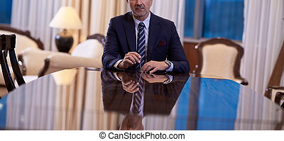 corporate businessman holding pen and gesturing with hands concpet of business deal