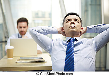 corporate executive thinking in office
