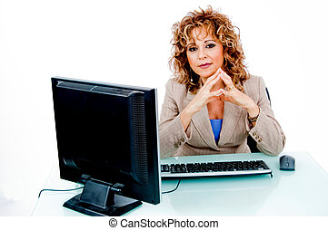 Corporate feminine at her desk