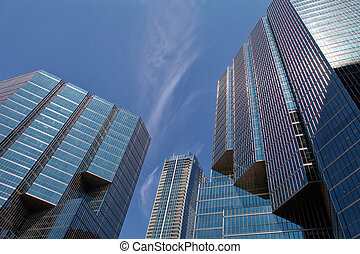 The view of the corporate office buildings on the blue sky background