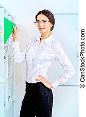 corporate - Image of a young businesswoman working at the...