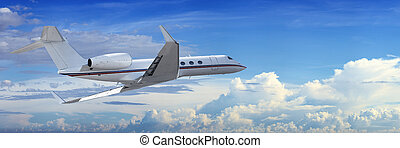 Corporate jet cruising in a cloudy sky