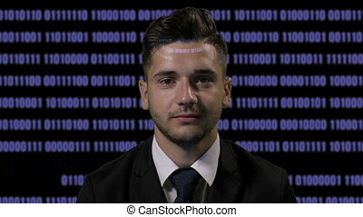 Corporate male developer programmer codding on futuristic holographic display on a dark background with blue binary code