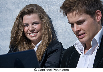 Corporate Man And Woman With Laptop