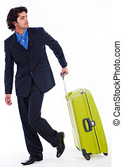 Corporate man looking back with the luggage