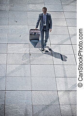 Corporate Man Walking With Luggage