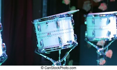 Corporate party. White drum kit on the stage. Close up