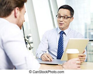 corporate people having an interesting conversation