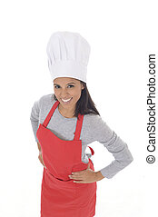 corporate portrait of young attractive hispanic home cook woman in red apron posing happy and smiling isolated