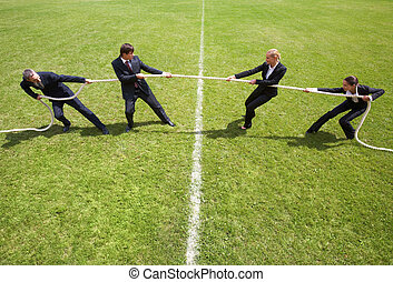 Corporate rivalry - Businessmen and businesswomen playing...