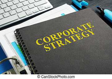 Corporate strategy plan and documents on a desk.