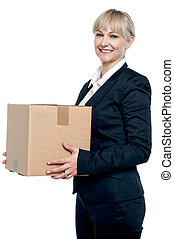 Corporate woman with a cardboard box in hand