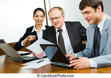 Corporate work - Photo of businessmen working with documents...
