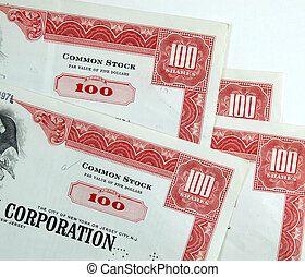 Red common stock certificates of an American corporation. Beautiful old documents of wealth.