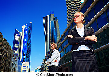 corporation - Business woman and business man standing in...