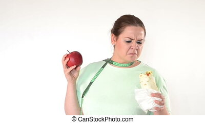 Corpulent woman struggle to eat healthy. Choosing healthy...